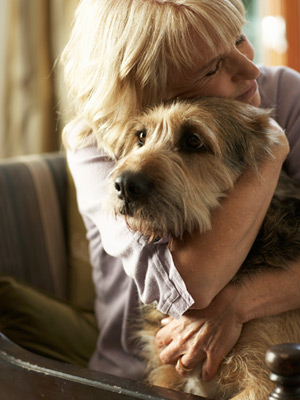 woman-hugging-dog-mdn